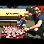 Exploding 100 Bottles Of Coke With A Steamroller
