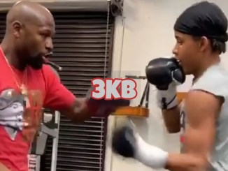 Floyd Mayweather Jr doing mitt work with his nephew