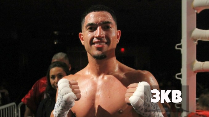 Brian Mendoza poses after victory