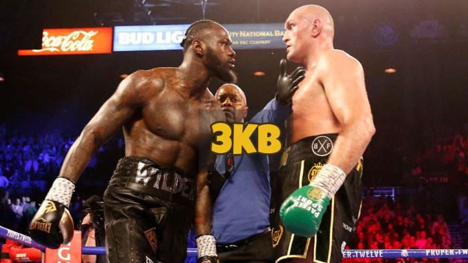 Deontay Wilder stares down Tyson fury in the middle of the ring