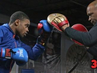 Derrick James (right) training Errol Spence Jr.