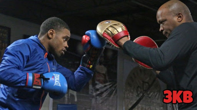 Derrick James (right) training Errol Spence Jr.