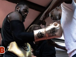 Mark Breland tying the gloves of Deontay Wilder