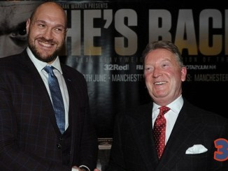 Tyson Fury (left) shakes hands with Frank Warren
