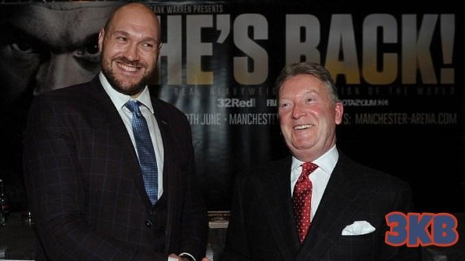 Tyson Fury (left) shakes hands with Frank Warren