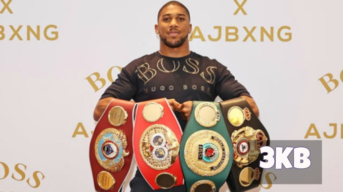Anthony Joshua holding his titles