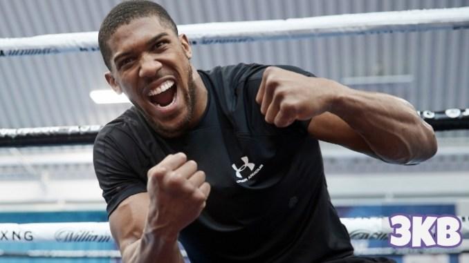 Anthony Joshua laughs during training