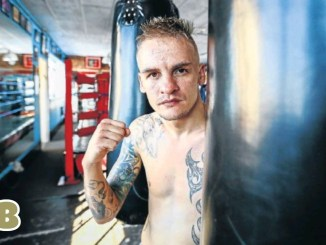 Hekkie Budler poses next to the heavy bag