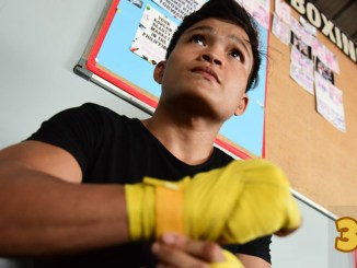 Jerwin Ancajas wraps his hands before training.