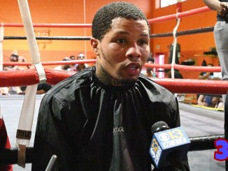 Gervonta Davis speaks to a reporter in the gym