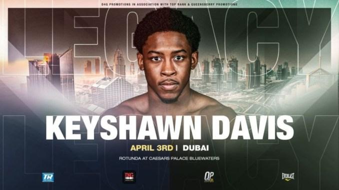 """Keyshawn Davis with the word """"Legacy"""" behind him"""