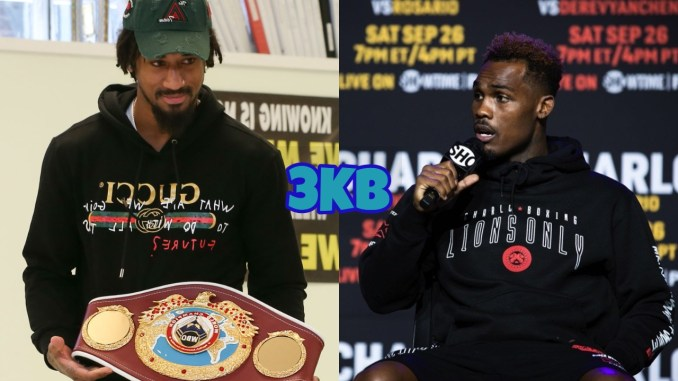 Demetrius Andrade offering a view of his WBO title, Jermell Charlo looking to his right while speaking into a microphone