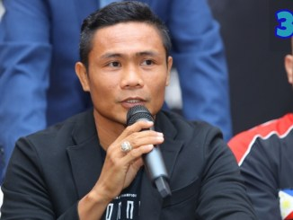 Donnie Nietes speaks into a microphone at a presser