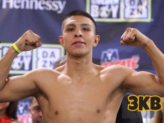 Jaime Munguia flexes his muscles at a weigh-in.