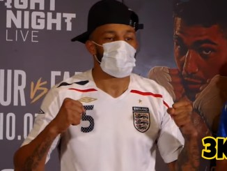 Lyndon Arthur poses at weigh-in for light heavyweight fight with Davide Faraci