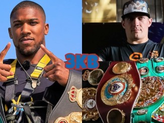 Unified heavyweight champion Anthony Joshua poses with his titles, former undisputed cruiserweight champion Oleksandr Usyk with his collection of belts