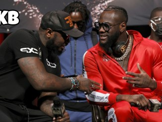 Deontay Wilder talking with Malik Scott at a press event during fight week
