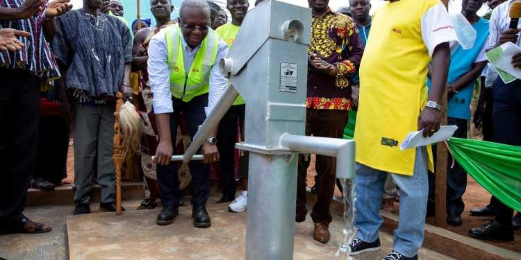 Mr. Ben Hassan Ouattara pumping the water to officially commission the two boreholes constructed by Vivo Energy Ghana