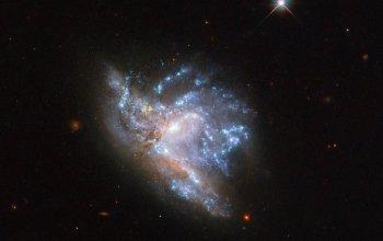 NASA  оприлюднило приголомшливе фото фіналу зіткнення двох галактик