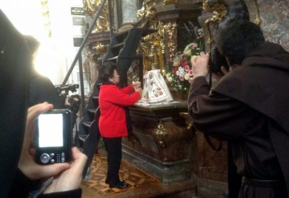 Mu sister, Susan P. Hauck changing the clothing of Infant Jesus in Prague
