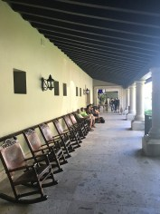The main lobby building has a row of rocking chairs outside. This is where you can wait for a cab or your shuttle bus.