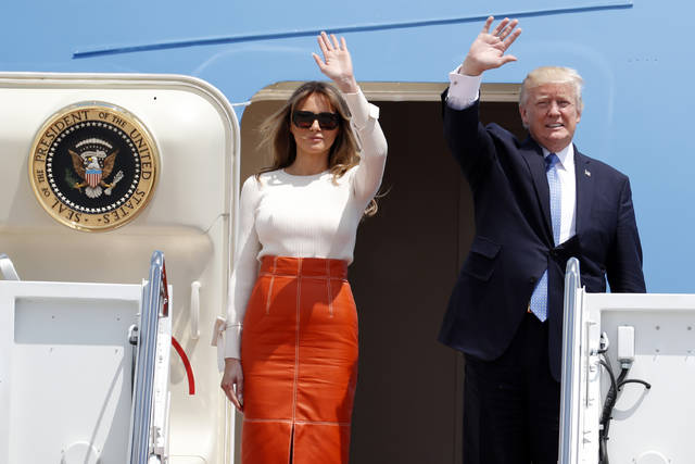 ASSOCIATED PRESS                                 President Donald Trump and first lady Melania Trump, wave as they board Air Force One at Andrews Air Force Base, Md. prior to his departure on his first overseas trip.