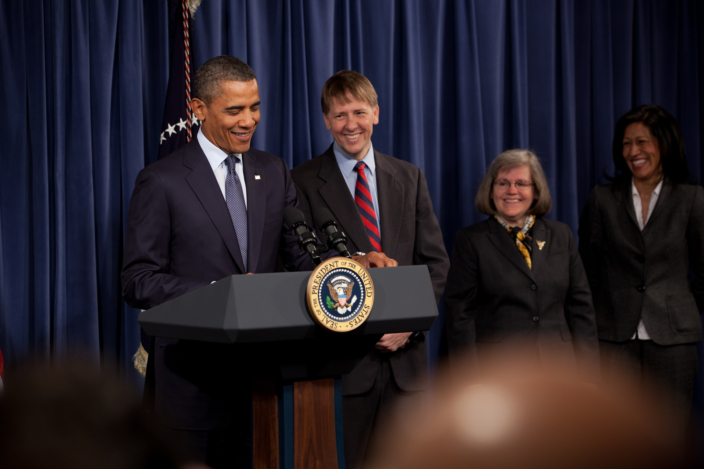 Why the CFPB Is Constitutional   Democracy Journal President Barack Obama at the Consumer Financial Protection Bureau with  Director Richard Cordray  2012