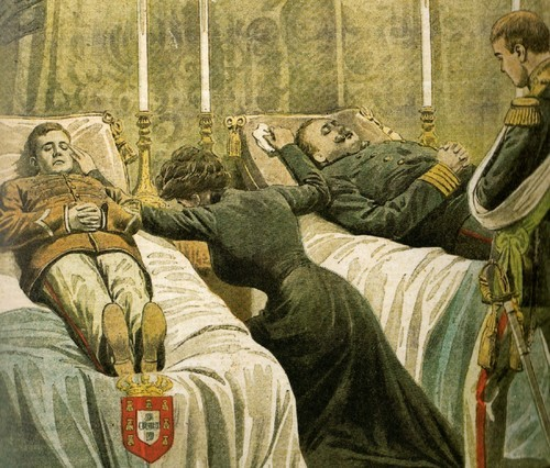 Queen Amelie of Portugal, crying in front of the corpses of her murderer husband king Carlos I (right) and her eldest son and heir to the throne the Prince Luís Felipe (left). Her other son, Manuel, was only shot on the arm and he became the last king of Portugal Manuel II. The royal family was in an open carriage in Lisbon, when two men determinate to end the monarchy shot in their direction. February 1st, 1908