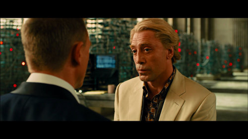 "With that butter slathered hair, the cream colored jacket and ambrosial dress shirt, and flamboyant nature in general, Javier Bardem's Silva seems, at first, entirely antithetical to Daniel Craig's James Bond. But their similarities is what makes the relationship dynamic intriguing. Silva knows how Bond operates and knows exactly how to get under his skin: by challenging Bond's ideal of masculinity. This sly, subversive action can be summed up easily by the use of one song: The Animals' cover of ""Boom Boom"". Late in the twenty-third James Bond film, Sam Mendes's Skyfall, Silva brings a massive helicopter and blasts the song towards Bond's home, taunting him, practically begging for Bond to walk out so Silva can continue to play mind games with him. And with the use of that song, one can delve into the twisted dynamic between James Bond and one of the most memorable villains in the franchise. […]  - ""Boom Boom"" and Bond's Masculinity in Skyfall // Movie Mezzanine"