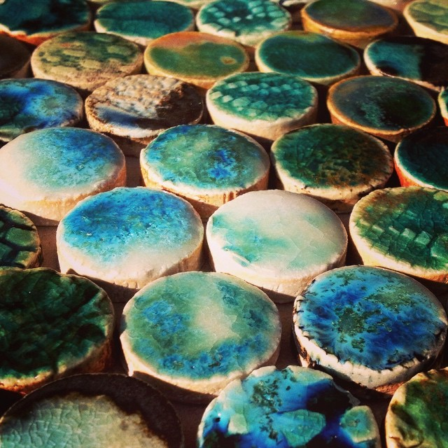 Straight out of the kiln! Crystal formation on penny-rounds #handmadetiles #ceramic #ceramics #pottery #pennyrounds #interior #decor #original #blue #crystals #art #guymitchell #guymitchellart #guymitchellartist #circles #tiles #mosaic