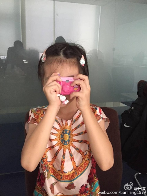 Cindy Tian Yucheng tries to take a picture without opening camera lens