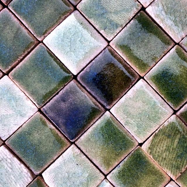 green glaze testing on mosaic squares, out of the kiln this morning. #green #greens #mosaic #mosaics #square #handmadetile #glaze #wall #decor #interior #interiordesign #guymitchelldesign #design