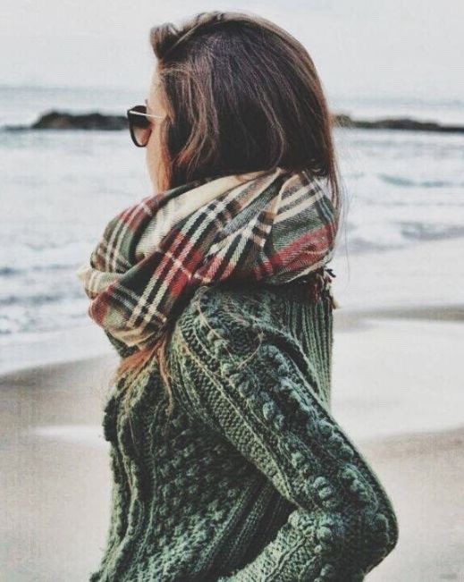 Plaid scarf with solid sweater.