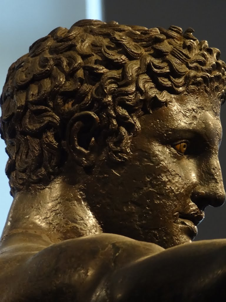 ganymedesrocks:panasfaidon:Museus Athens Efivos Adikithira 4th Century B.C. The Antikythera Ephebe, here a profile head detail of the bronze statue of a young man of languorous grace, which was found in 1900 by sponge-divers in the area of an ancient shipwreck off the island of Antikythera, Greece.
