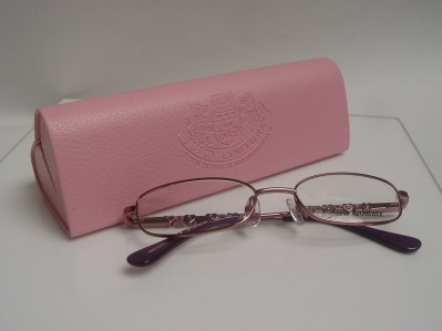 Juciy Couture Eyeglasses and pink heart shaped eyeglass case.