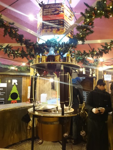 A vat of apple cider in Belfast. Note the amaretto and rum that can be easily piped down into your cider.