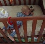Baby stuck in the cot bars