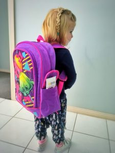 Kinder school bag almost as big as she is.