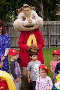 Alvin rests his hands on a child's head