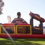 Lightning McQueen Piston Cup inflatable jumping challenge.