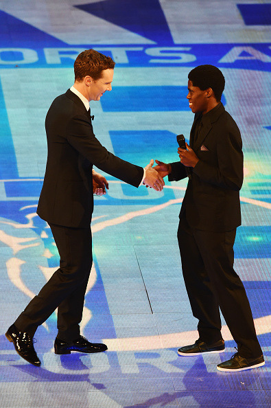 Benedict Cumberbatch greets skateboarder Thalente Biyale onstage during  the 2015 Laureus World Sports Awards show at the Shanghai Grand Theatre  on April 15, 2015 in Shanghai, China.