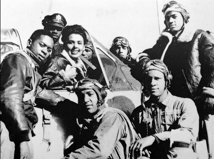 Lena Horne with a group of Tuskegee Airmen on January 1, 1945. There are countless photos of Ms. Horne visiting Tuskegee Airmen and other military personnel to show her support for their service. She also showed her support for them by refusing to perform for segregated military audiences during World War II. Photo: Associated Press.
