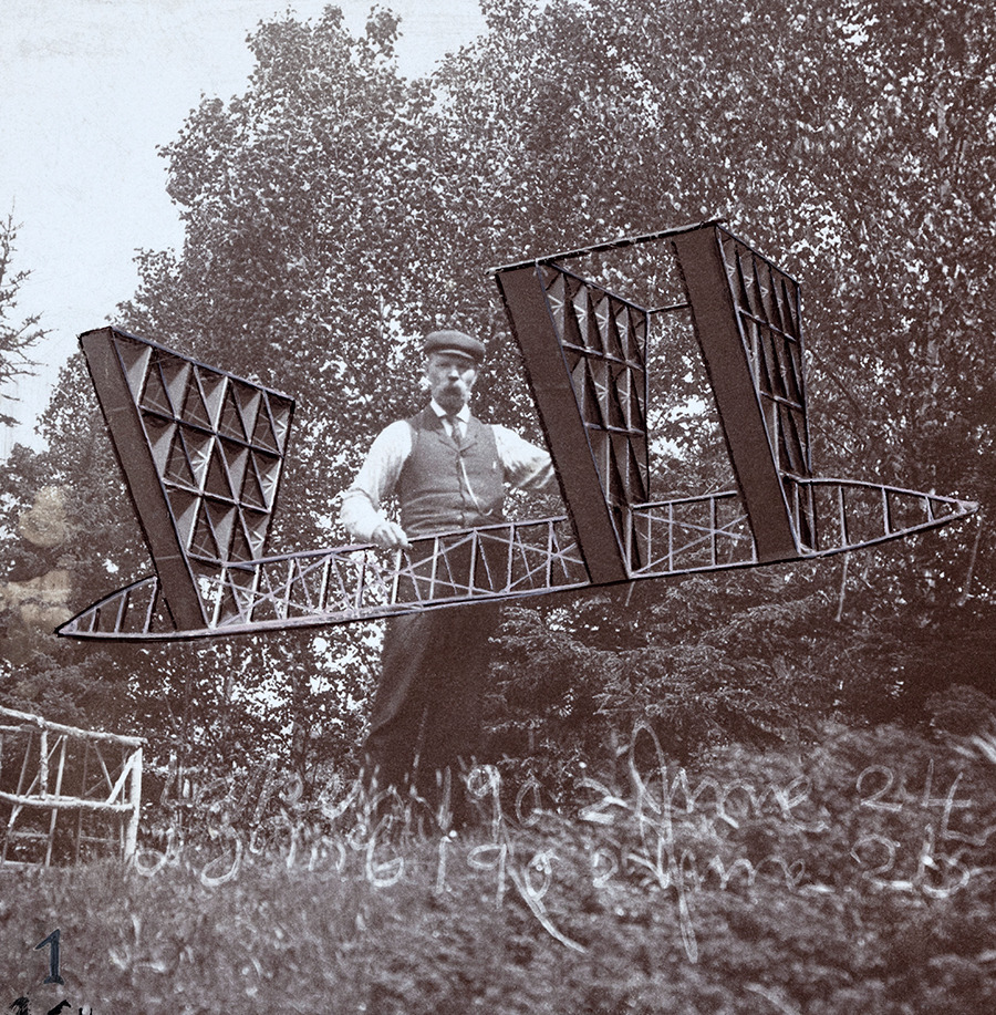 An Alexander Graham Bell associate holds a multicelled kite, 1903.No Credit Given