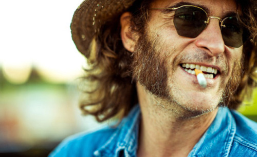 A haze of smoke uncoils and dances in the air, slinking out from of the mouth of Doc Sportello (Joaquin Phoenix), part-time private investigator and, ostensibly, full-time pothead. So light and loony this character (and film) is,Inherent Vice almost comes as a surprise to those following the career of Paul Thomas Anderson, whose last few films have fit, for the most part, comfortably within a mode of seriousness. Vice, while hard to describe as frivolous, is not as married to that tone, instead taking on something goofier, funnier, and consistent with Anderson's work; something enjoyably off-kilter. […]  - NYFF2014: The Long Good High - Inherent Vice // The Movie Scene