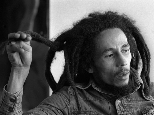 "Jamaica's Take on Bob Marley Differs from His Global ImageDonate - Subscribe - Reblog - LikeBob Marley's image in his homeland contrasts from the common international view of the late singer and musician as the epitome of reggae, Rastafarianism, marijuana and even Jamaica itself.""Whereas many foreigners think Bob Marley is above everybody else, in Jamaica he is seen as equal to other artists,"" Ray Hitchins, a lecturer in the Institute of Caribbean Studies at the University of West Indies, told Efe.""Celebrities are not put on a pedestal here like in other places of the world,"" he said, while adding that Jamaicans are aware of how much the island's tourism and economy has benefited from their country's most famous son, who would be 70 on Friday.In Jamaica, Marley shared the spotlight with many other reggae stars, such as Dennis Brown, Gregory Isaacs, John Holt and Peter Tosh, who was Bob's bandmate in The Wailers before embarking on a solo career.The world discovered Marley thanks to the vision of Island Records founder Chris Blackwell, who introduced Bob's persona and songs to international markets.""One of the major attractions of the Bob Marley's history is who he is, where he comes from and how he reached people,"" Hitchins said, referring to the singer's humble origins.Hitchins, an expert in ethnomusicology, emphasized that with their 1972, Blackwell-produced album ""Catch a Fire,"" Marley and the Wailers gained international recognition by addressing political themes that challenged the status quo.""He was politically conscious. He was ahead of his time,"" Hitchins said, noting that Marley ventured to question white supremacy just a decade after Jamaica independence from the United Kingdom.In fact, Marley was one of the first reggae artists to publicly acknowledge that he was a follower of Rastafarianism, a faith that venerates Ethiopia as the biblical Zion and promotes black repatriation to Africa.Though his Rasta identity was not entirely a plus in Jamaica, where Rastafarians then faced discrimination, it added to his mystique internationally.Marley, according to Hitchins, is more famous now than before his death from cancer in 1981, due in large part to the systematic marketing – promoted by his own family – of his image and brand to the point of making it a ""synonym for Jamaica.""The sale of T-shirts, albums, coffee and even cannabis under the brand of Bob Marley indicate that the reggae icon's popularity will only increase, Hitchins said.""His legacy is not complete. His influence continues to grow and expand. It has not met its full potential,"" he said."