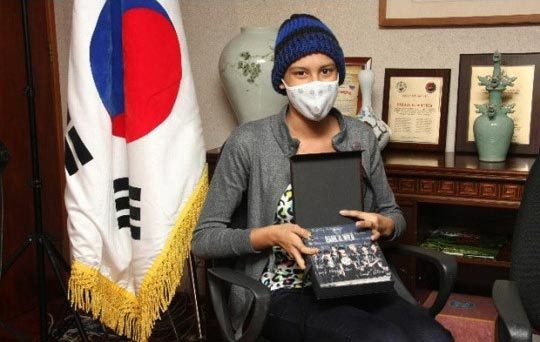 """BTS Does Something Incredible for an A.R.M.Y Battling Cancer."" Going Viral.<br /> [[MORE]]<br /> Article By: CJ E&M enewsWorld Grace Danbi Hong Going past borders, the BTS members sent heartfelt encouragement and support to a fan in Venezuela who is battling cancer. On December 12, Rahily Ramos, a young 15-year-old girl who is currently fighting cancer, received the gifts that she has been longing for. With Rahily Ramos being a huge BTS fan, especially of Jin, her family sought out help at the Korean Embassy in Venezuela three week prior, asking if there was any way to receive a message of support from BTS to encourage Rahily Ramos as she receives treatment. The Korean Embassy immediately contacted Big Hit Entertainment, and upon hearing the unfortunate and moving story, BTS replied, sending her warm messages of support and encouragement as she bravely tackles this disease. The group also delivered signed CDs to the Korean Embassy, who later brought the gifts to Rahily Ramos.Rahily Ramos expressed her happiness, saying her dreams came true, while her mother said this was the greatest present they′ve received this year. Photo Credit: Big Hit Entertainment"