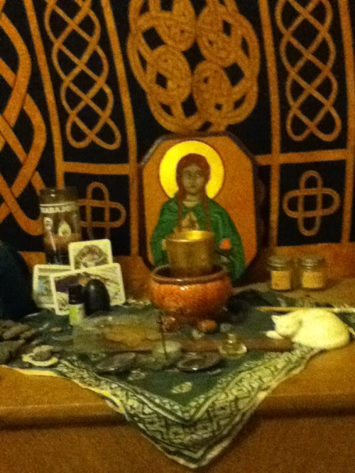 My old altar to Brigit. I go for the more is more attitude with altars, as you can see :9 I did my flame tending shifts at this altar. As well as other petitions and daily observances.