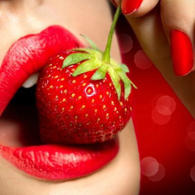 Woman Sensual Red Lips Eating Strawberry