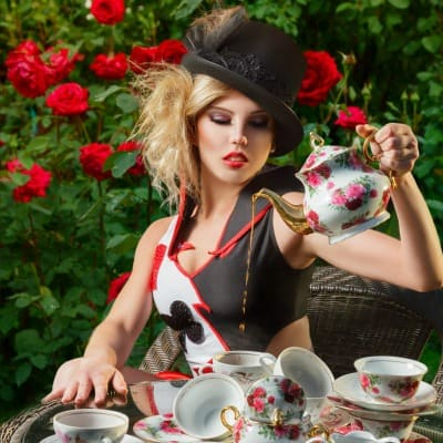 Blissful Black Tea Review, Sexy Queen of Hearts, Beautiful Woman Drinking Tea, Marijuana Edibles, Stillwater Brands