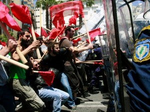 Protesters clash with policemen during riots at a May Day rally in Athens